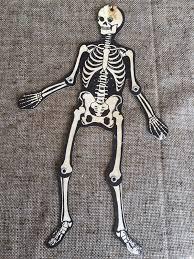 vintage riveted jointed skeleton halloween die cut cardboard