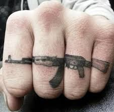 22 adorable gun finger tattoos