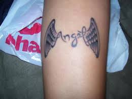 wing tattoos on wrist