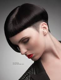 sculptural short haircut with sharp lines and a shorter side