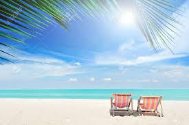 Sand Beach by Beach Chairs On The White Sand Beach With Cloudy Blue Sky Stock