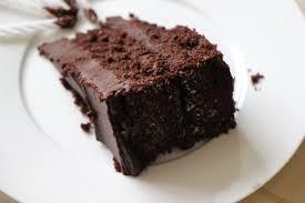 yellow birthday cake with chocolate ganache frosting image