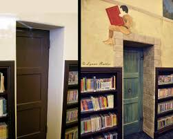 the ornamentalist library children s room mural completed small maintenance door transformed into a secret castle entrance