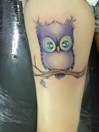 funny cartoon like colored little owl on a branch tattoo tattoo wf
