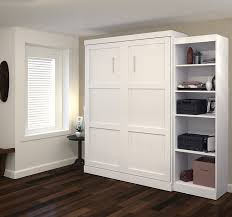 bedroom white paint crown molding with dark hardwood floor also