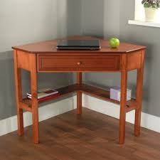 cherry wooden corner computer table in triangle shape having