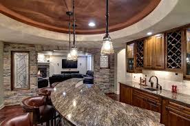 basement bar illuminated with pendants and ceiling lighting
