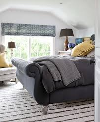 traditional home bedrooms a tufted bed and wing chair make this bedroom cozy traditional