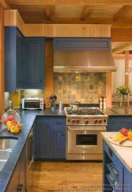 blue kitchen cabinets in cabin the backsplash the blue washed cabinets are really