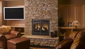 stacked stone fireplace to create western interior and exterior awesome design of the stacked stone fireplace with brown wooden storage added with brown leather seat