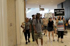 target hours mo arnold black friday police arrest 22 protesters at galleria mall lawyers complain