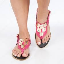 dark pink leather sandals with gold applied on feet the mujere on