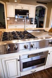 tile countertops kitchen island with range lighting flooring