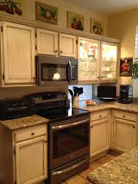 kitchen appliances ideas glazed kitchen cabinets with black appliances painting over image