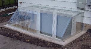 basement window well metal and clear plastic window well covers