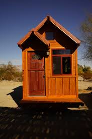 man builds modified tiny home using plans