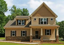 cream exterior paint color combinations with stone pole can add