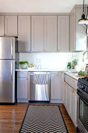 best images about kitchen design pinterest beautiful kitchen with gray cabinets and brass hardware