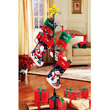 decorating personalized stocking holders with christmas stocking