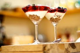 martini strawberry mixed berry and vanilla cheesecake in a martini glass food in