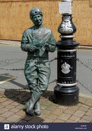 motorcycle leathers a statue of george formby wearing motorcycle leathers and helmet
