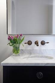 brass vanity faucets transitional bathroom natalie clayman