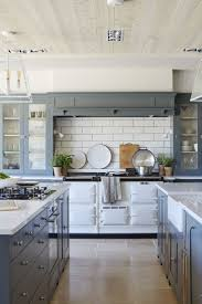 best 25 double island kitchen ideas only on pinterest kitchens modern farmhouse kitchen with a vintage stove