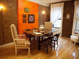 contemporary brick dining room with orange accent wall hgtv design
