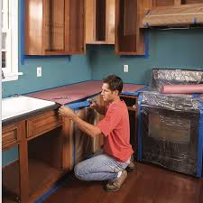 is it better to paint or spray kitchen cabinets how to spray paint kitchen cabinets diy family handyman