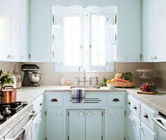 Light Blue Kitchen Cabinets by Blue Kitchen Cabinets With Wooden Knobs Wood Counter Favorite