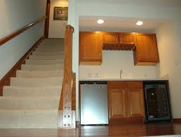 open carpeted stairwell with banister bar area with countertop