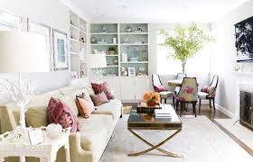 living rooms white built ins lined blue grasscloth wallpaper tan