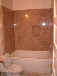 bathroom rectangle bathtub with steel rain head shower brown bathroom and wall tiles