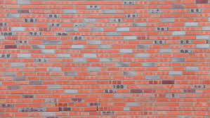 rain in the city on brown bricks house wall background stock