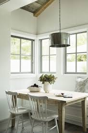 round table corning ca simple wooden table and white chairs for a small corning dining area