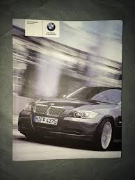 2006 bmw 323i 325i 325xi 330i 330xi owners manual set with case