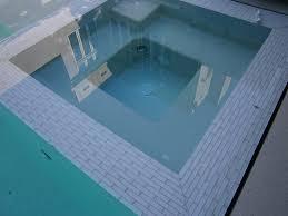 infinity mirror negative edge pool in small backyard
