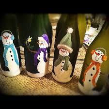 painted snowmen on wine bottles with 20 mini lights acrylic paint