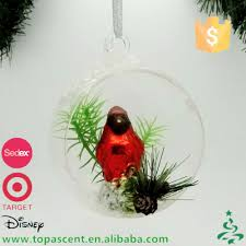 hand blown glass squirrel standing on real pine cone decorations