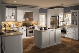 range in kitchen island contemporary brown wood floor white wooden cabinet pendant lamp