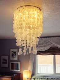 decor smart style capiz shell chandelier with white curtains