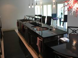 contemporary brown wooden island with beige granite countertops