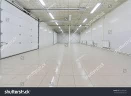 empty light parking garage warehouse interior stock photo