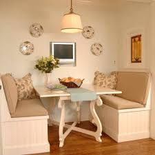 chic kitchen breakfast nook with metal table with oval shape glass