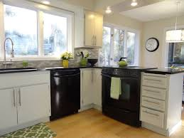 l shaped kitchen with black appliances cleaning your black