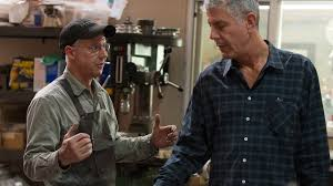 anthony bourdain watches as master bladesmith bob kramer crafts a