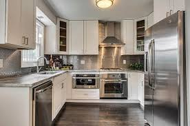 white kitchen cabinets with stainless steel backsplash inspiration from kitchens with stainless steel backsplashes