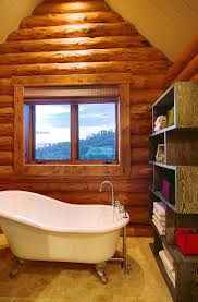 rustic log retreat blends modern accents and spectacular views colorado log cabin teen bedroom tub area