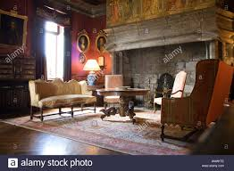 livingroom with french style stock photos livingroom with french old castle sitting room with hearth fireplace stock image