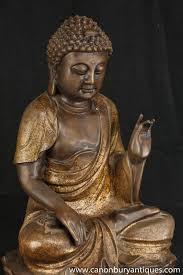 spiritual statues photo of bronze burmese buddha statue meditation pose buddhist